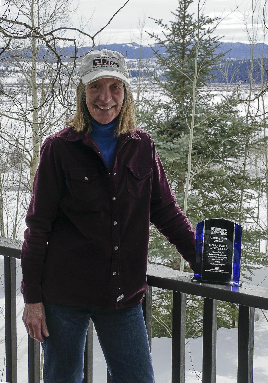 Debra Patla with her Unsung Hero Award