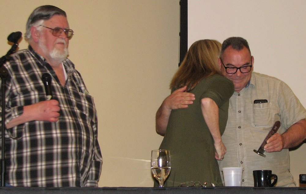 Bruce Bury presented Jamie with his award and Katy Weil, current NW PARC co-chair, gave Jamie a congratulatory hug.