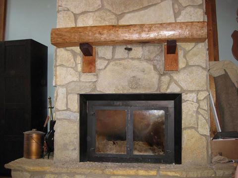 Hand-hewn cherry mantle, purple heart corbels custom made for a fireplace in Chillicothe