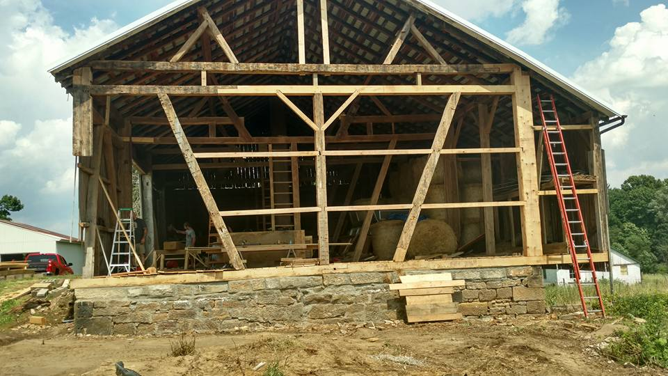 Bank barn with the west bent having rot in the sill, posts, and tie beams. Completed repair in Brewster, Oh.