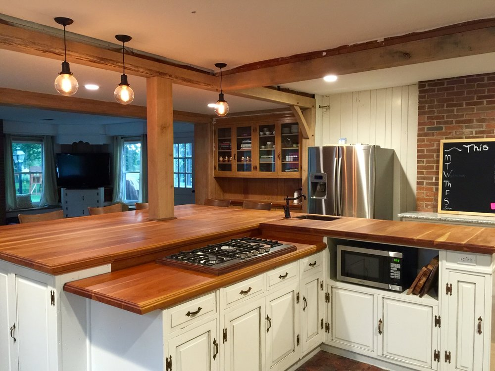 Kitchen remodel, custom island and cabinets, ceiling beams for opening up the room.