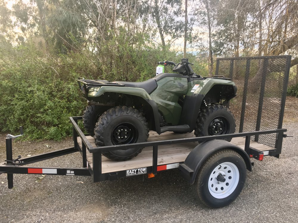this year we are happy to be able to offer a green 4x4 honda rancher 420cc with 5x8 eazy tow trailer as our featured raffle item
