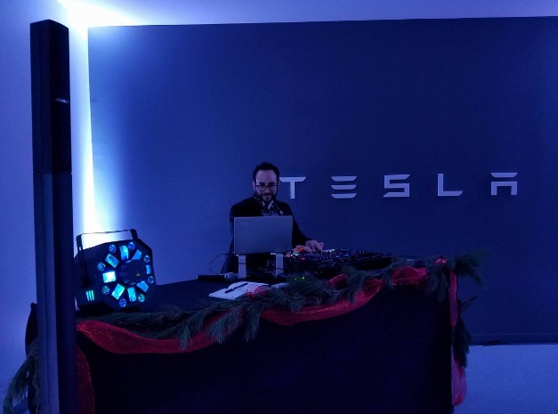 New Jersey/New York DJ Michael Demby entertaining at a company holiday party for Tesla in Brooklyn, New York