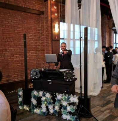 DJ Michael Demby at the wedding of Rena and Jason in Brooklyn, New York