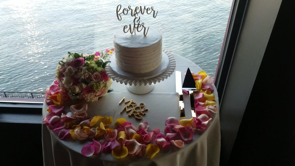 Simple Single Layer  - For the bride and groom, this cake was all about placement and the layout of the accoutrements.