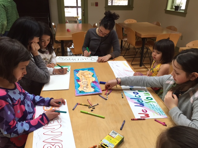 "A group of families making ""Welcome Home"" signs for the brothers expected to arrive this week."