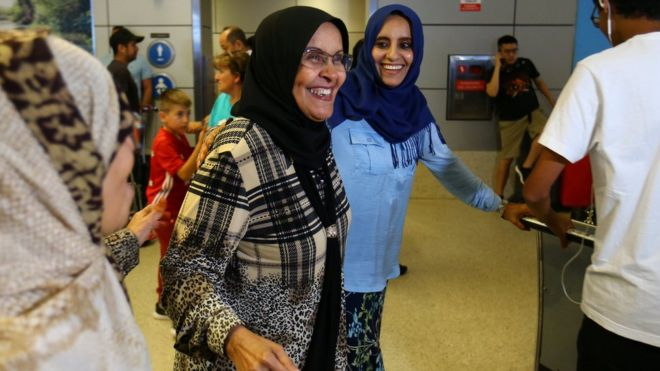 A woman (middle) travelling from Jordan on a Yemeni passport arrives in Los Angeles, California