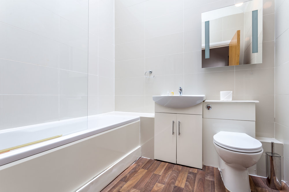 "Bathroom<a href=""/area-of-your-site"">↑</a><strong>Hairdryer, Iron/Ironing board, Linen and Towels Provided, Shower above bath,Laundry Facilities.</strong>"