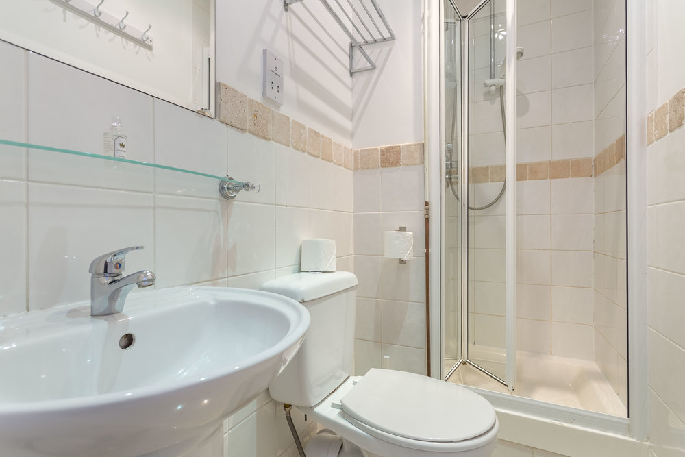 "Bathroom<a href=""/area-of-your-site"">↑</a><strong>Hairdryer, Iron/Ironing board, Linen and Towels Provided, Shower above bath, Laundry Facilities.</strong>"