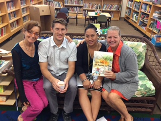 The staff at the school in Hawaii posing with my book.