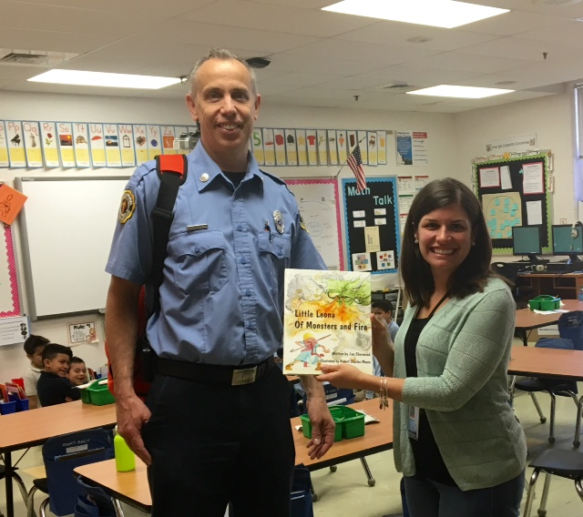 Annapolis Fire Marshal reading Little Leona to a class.