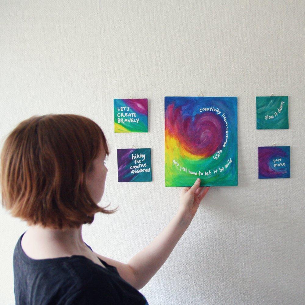 Elin Lööw in her studio with her work.