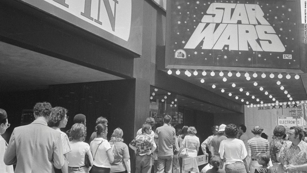 A long line of theatre patrons angrily demanding their money back after walking out of  Star Wars .