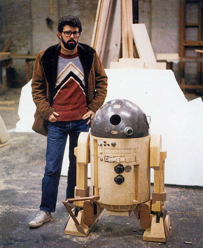 George Lucas photographed beside a fancy trash can, circa 1976.