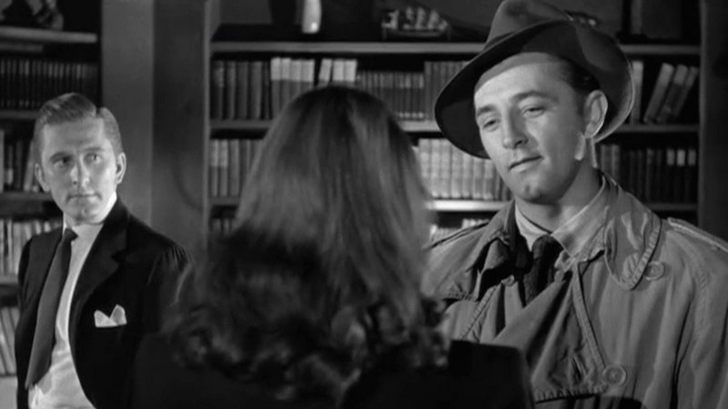 Robert Mitchum and Kirk Douglas in  Out of the Past .