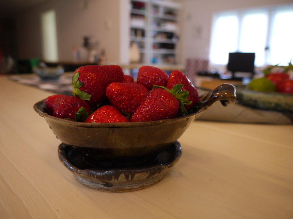 Fresh strawberries in my hand made berry bowl.