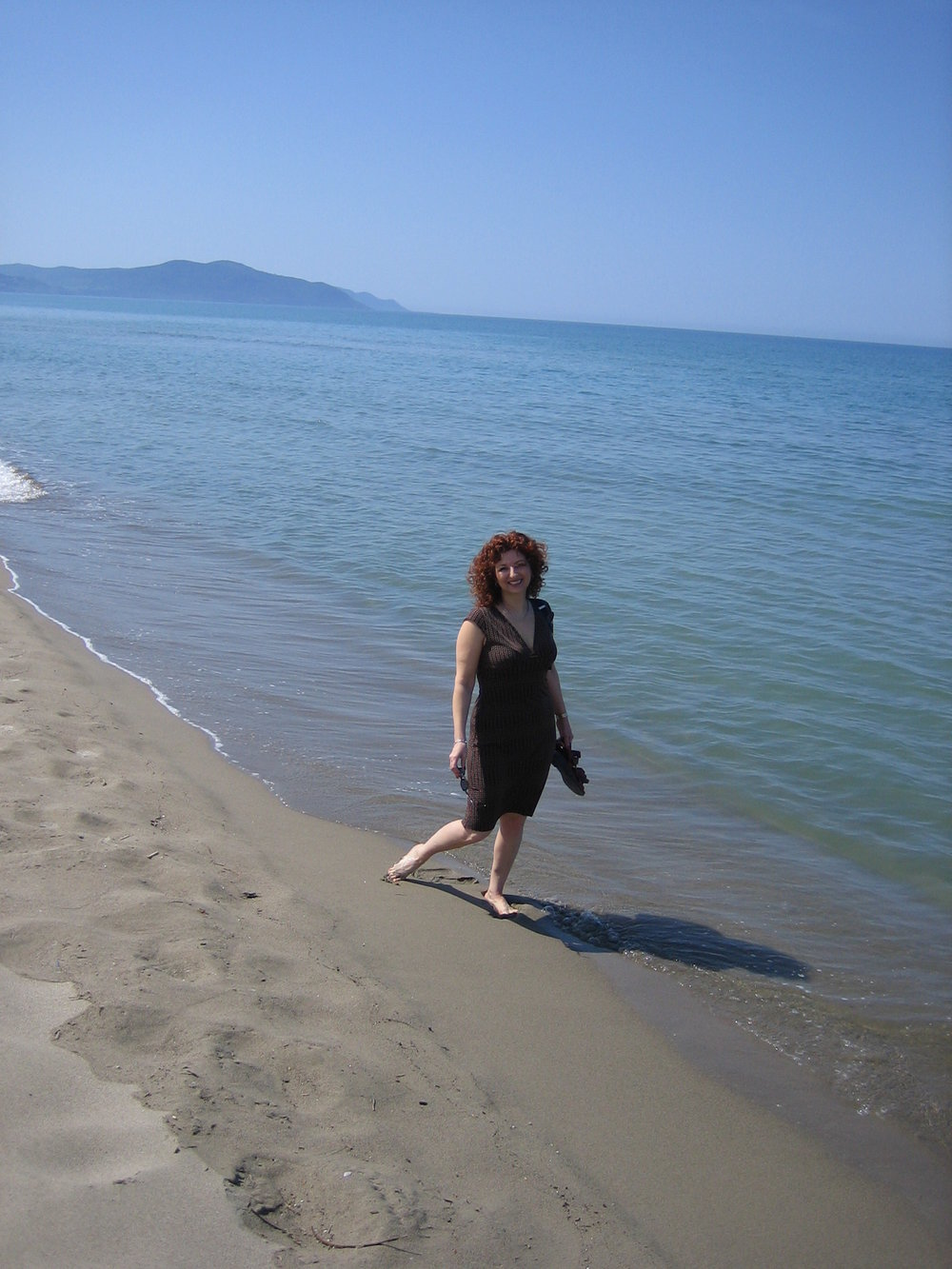 Walking on the empy beach, Paestum, Italy