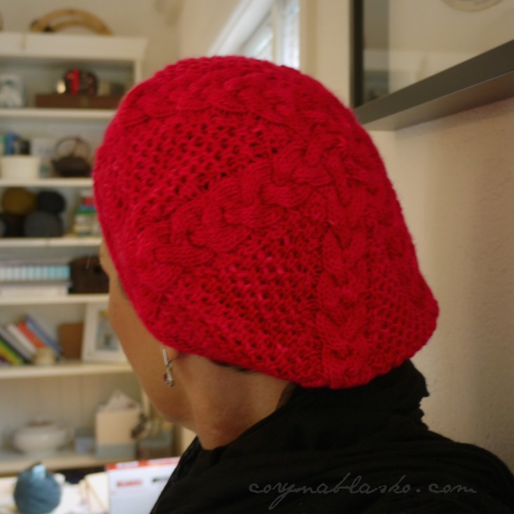 Grouse Dance Beret, back view. the braided cables alternate with half-brioche panels.