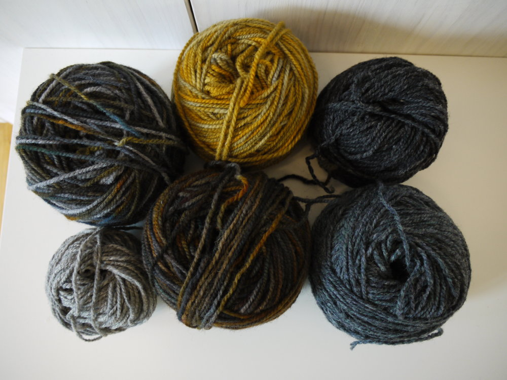 The three variegated yarns are ones I dyed myself. The 3 solids are Briggs & Little colours.From the middle top Ochres (custom dye), Charcoal, Seafoam, Bronze Age (custom dye), LIght Grey, Steel Rails (custom dye).