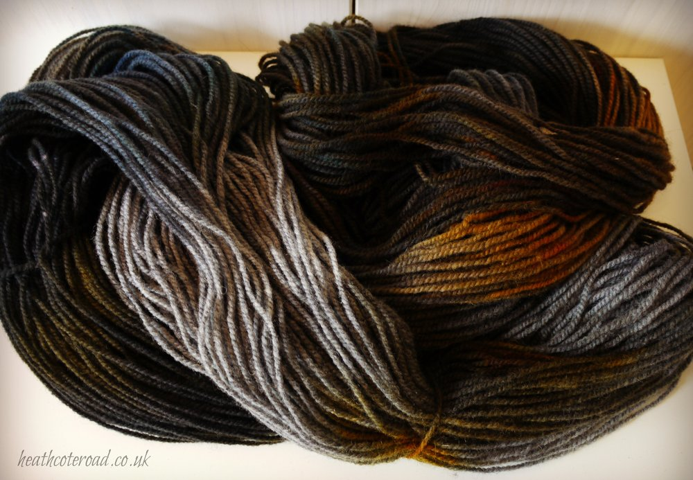 Two of my skeins of hand dyed yarn before they were wound into yarn cakes. Same dye colours, but different base colours.