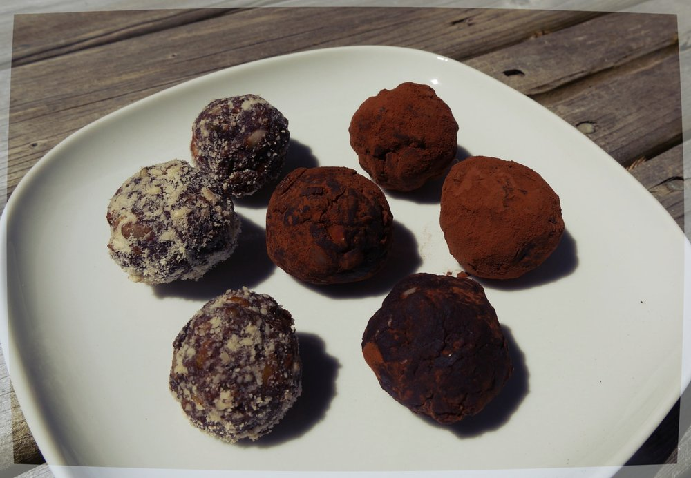 Here they are! Some I rolled in organic cocoa powder, others were rolled in ground almonds.