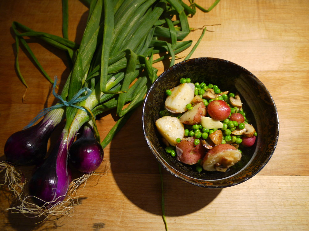 Fresh from the farmer's market. Spring potatoes, peas & red onions.