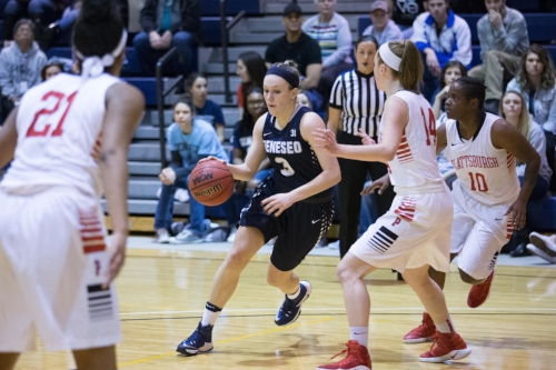 Senior guard Kayleigh Cavanaugh takes the ball up the court during the Knights game against SUNY Plattsburgh on Saturday Jan. 21. The women finished the home game with a 66-46 victory, contributing to their perfect 18-0 record for the season.