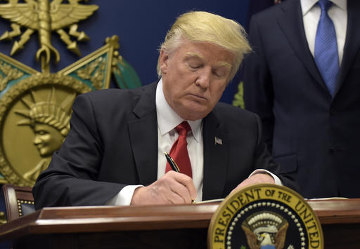 President Donald Trump signed an executive immigration order on Friday Jan. 27 preventing refugees from immigrating into the United States for 120 days. This order also prevents travel from seven Muslim-majority countries to the U.S. for 90 days. (Susan Walsh/AP Photo)