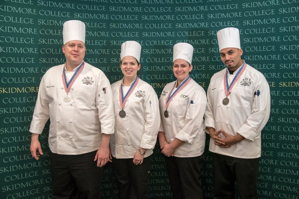 Campus Auxiliary Services enlisted four of its chefs in a Market Basket Culinary Competition at Skidmore College, including Executive Chef Matthew Laurence, Chef Michelle Halloran, Chef Illana Stevenson and Chef Wilson Castillo (pictured left to right). The team won a silver medal along with six other colleges. Despite the recognition CAS has received, students are still wary of the quality of the food the company provides.