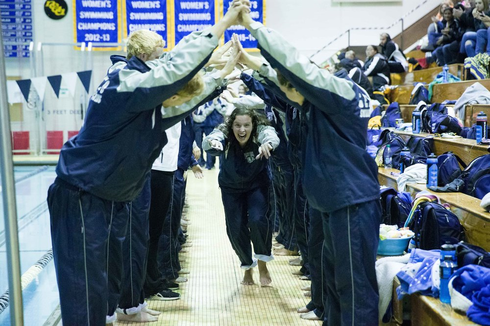 The Geneseo Blue Wave swim team gets hyped up before the start of their home invitational on Saturday Jan. 28. Both sides had a successful meet; the men took first place out of six teams, while the women took first out of five teams. (Keith Walters/Campus Photographer)