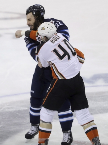 Foward Jared Boll for the Anaheim Ducks fights right winger Chris Thorburn of the Winnipeg Jets during the first period of a National Hockey Game in Winnipeg on Jan. 23. Fights like these are a common issue during NHL games and contribute to head trauma. (Trevor Hagan/AP Photo)