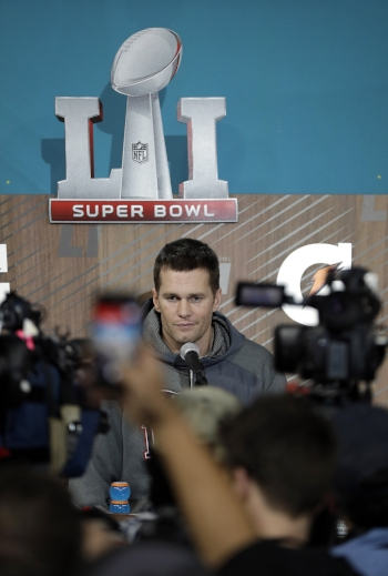 Quarterback Tom Brady of the New England Patriots answers questions during a press conference for the National Football League Super Bowl 51 on Monday Jan. 30. (David Phillip/AP Photo)