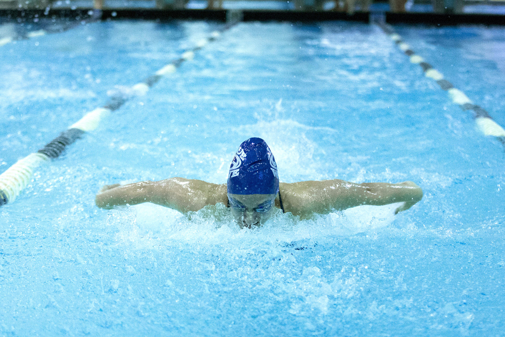 Both the men and women swam into first place during the Geneseo Invitational on Jan. 28. The team looks to continue their success in their upcoming meets, as they are sending athletes to the Ithaca Invitational and to SUNYACs. (Keith Walters/Campus Photographer)