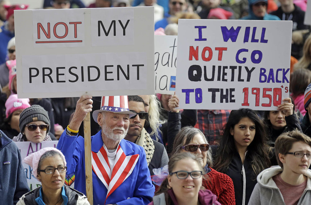 Demonstrators protest against President Donald Trump in Salt Lake City, Utah on Monday Feb. 20. Recently, Trump voters who are disappointed with Trump's presidency accuse anti-Trump leftists of bullying and discriminating against them. (Rick Bowmer/AP Photo)