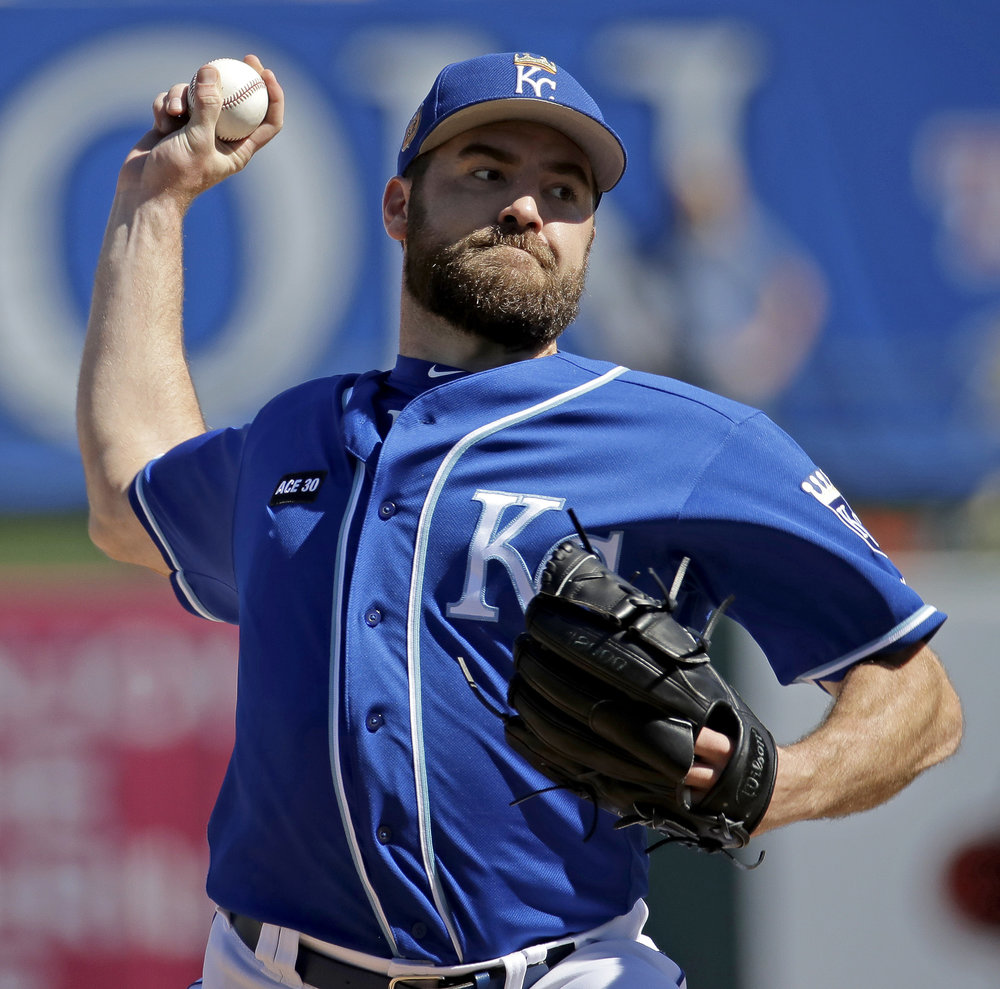 Nathan Karns, starting pitcher for the Kansas City Royals, throws a pitch during the first inning of a game against the Chicago Cubs during spring training on Wednesday March 1. (Charlie Riedel/AP Photo)