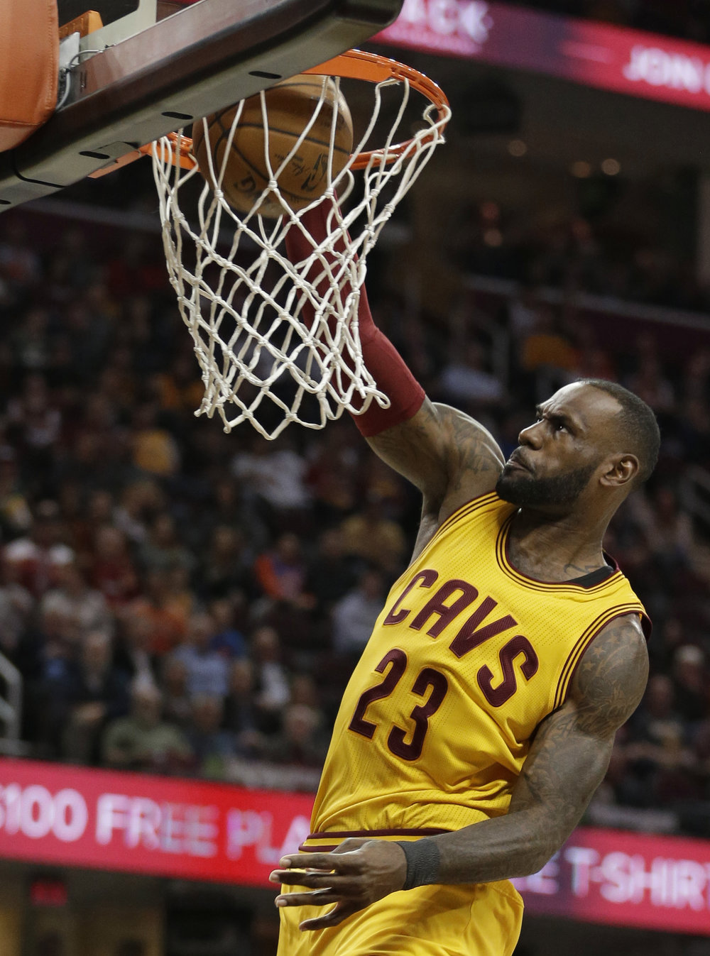 LeBron James of the Cleveland Cavaliers dunks the ball during the first half of a game against the Millkwaukee Bucks on Monday Feb. 27. Many players seem to be making questionable financial decisions when signing contracts with teams. (Tony Dejak/AP Photo)
