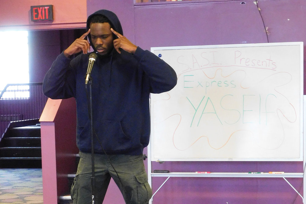 Andre Doeman '15 performs at the Students Against Social Injustice's third annual Express YaSelf event on Sunday Feb. 26. Students were invited to recite poetry, songs and other creative mediums to express themselves and educate their peers about recent social issues. (Jenna Harbus/Staff Photographer)