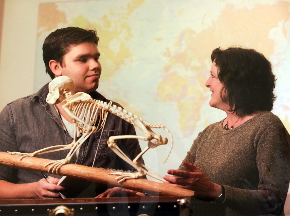 Associate professor of anthropology Barbara Welker has traveled near and far to study eating habits of primates, specifically howler monkeys. Geneseo alumni and former student of Welker, Keenan Taylor, is pictured with the skeleton of a primate. (Courtesy of Barbara Welker)