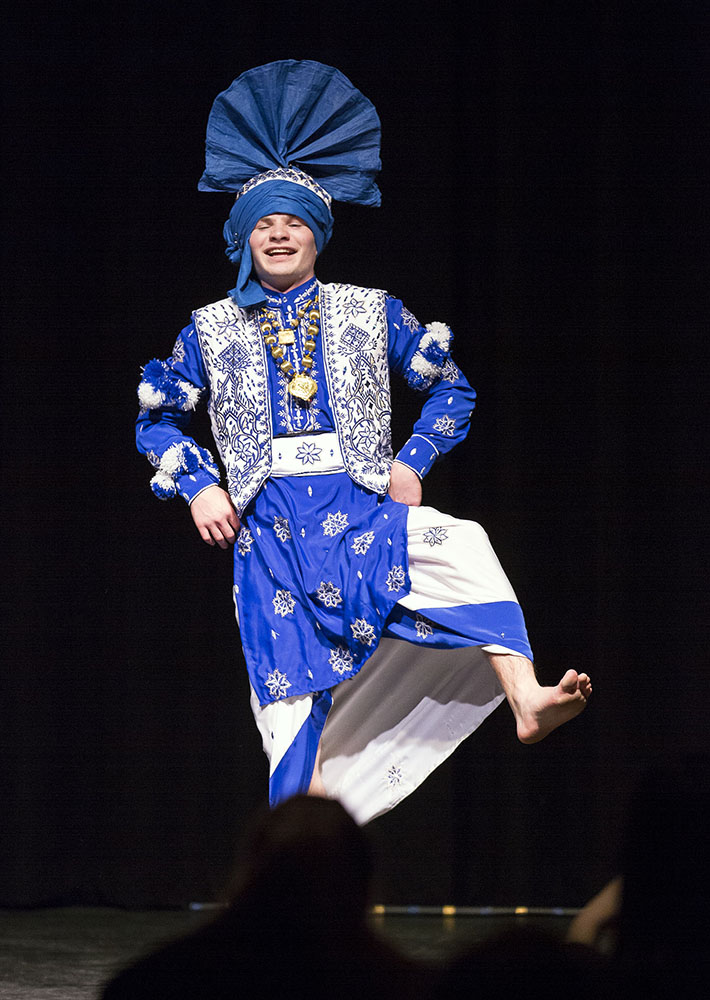 """Complete with a traditional Indian food dinner, Geneseo Bhangra's """"Mela"""" event hosted a myriad of dance performances. Senior Kyle Fletcher (pictured above) took part in Bhangra's performance. (Annalee Bainnson/Assoc. Photo Editor)"""