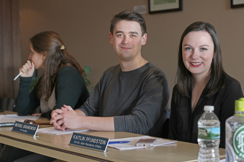 Geneseo's new Student Association executive committee has been elected for the 2017-18 academic year. Adolescent education major junior Kailtlin Pfundstein (right) will serve as SA's new president, replacing current SA president senior Michael Baranowski (left). (Ash Dean/Photo Editor)