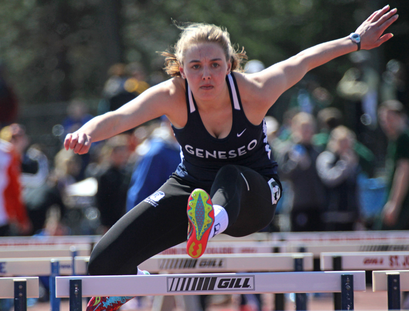 Freshman multi-event athlete Alexa LaPierre represents the Geneseo Knights in the 100-meter hurdles at the Geneseo invitational. The home meet put Geneseo at an advantage as they had friends and family on campus to cheer them on. (Ash Dean/Photo Editor)