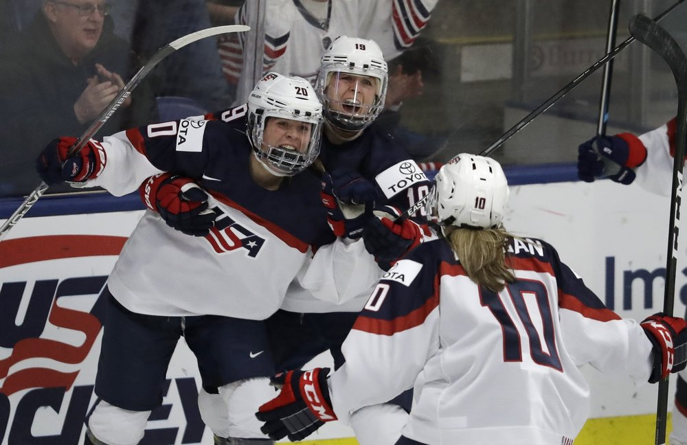 United States forwards Gigi Marvin and Meghan Duggan celebrate teammate forward Hannah Brandt's goal during the third period of an International Ice Hockey Federation World Championship game, in which the women took a 5-3 victory over Finland on Monday April 3. The women feel more stability playing the game they love, as they have recently obtained greater pay equality. (Carlos Osorio/AP Photo)
