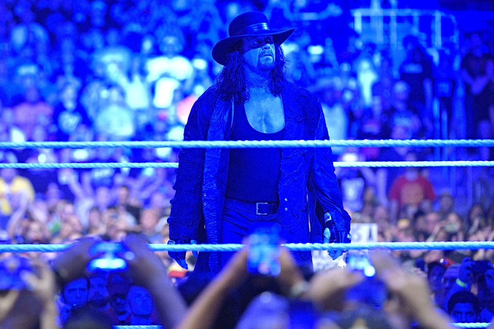 The Undertaker looks at the crowd after entering the ring for his last WrestleMania match on Sunday April 2. The performance that World Wrestling Entertainment athletes put on kept their fans on edge, as they not only provided wrestling matches, but also John Cena's proposal to Nikki Bella. (Phelan M. Ebenhack/AP Photo)