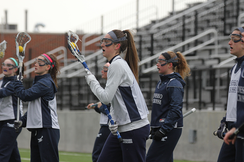 Senior forward Kathleen Depillo leads her team in a drill during the women's practice. The Knights had a successful game against Buffalo State College, beating them 12-11, and they look to maintain this momentum during their upcoming game against SUNY Cortland on Saturday April 15. (Ash Dean/Photo Editor)