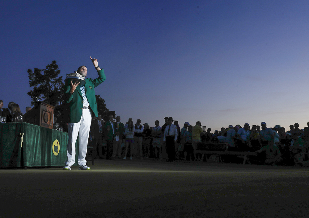 Spain's Sergio Garcia Fernandez celebrates his victory by holding up his Masters trophy at the green jacket ceremony after the tournament on Sunday April 9 in Augusta Georgia. Golf fans anticipate the spring season as it allows for the most skilled golfers to show why they are the best. (Sergio Garcia/AP Photo)