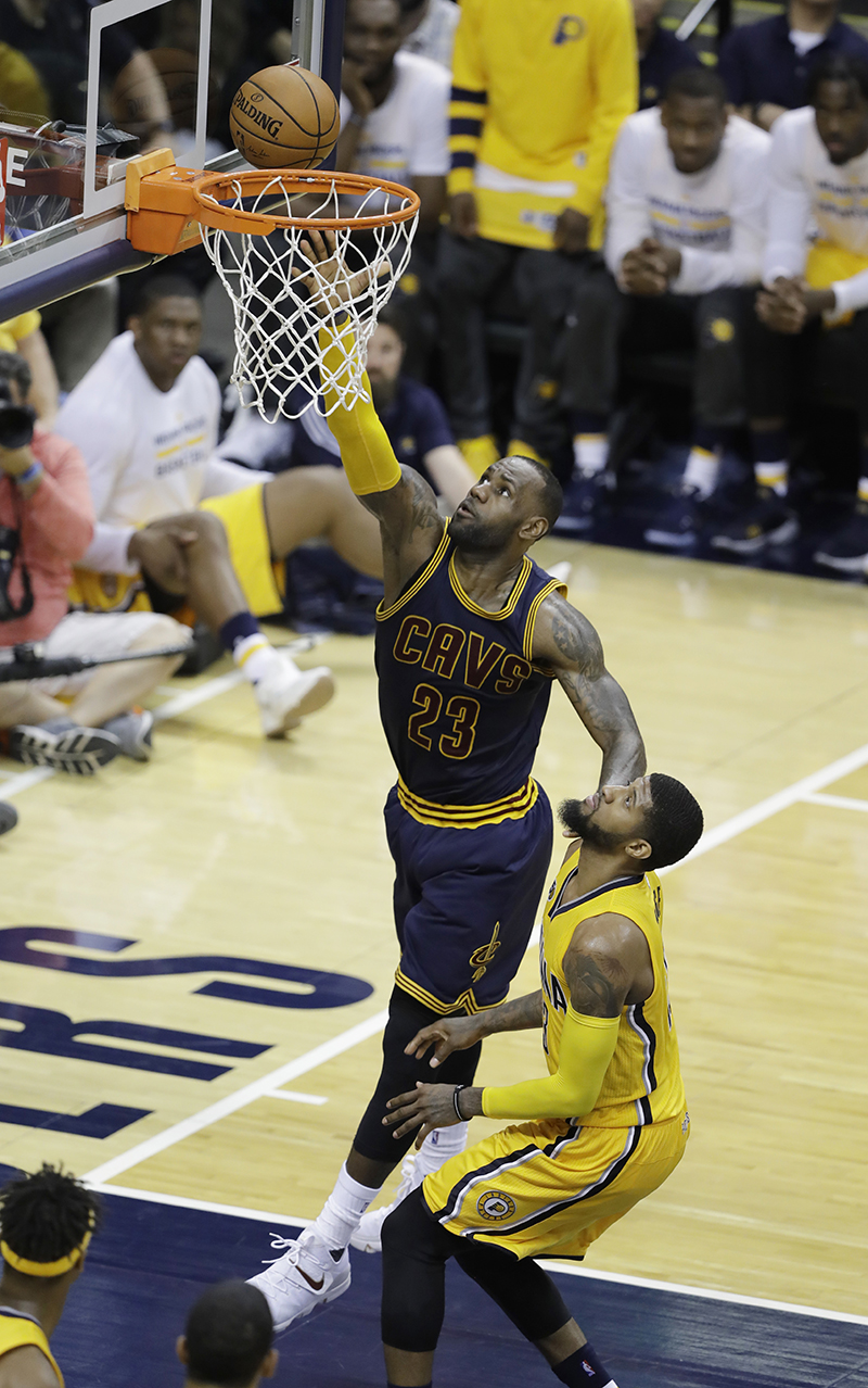 LeBron James of the Cleveland Cavaliers scores against Paul George of the Indiana Pacers during the second half of Game 3 in the National Basketball Assocation playoff series. The Pacers fell 119-114 to Cleveland on Thursday April 20. (Darron Cummings/AP Photo)