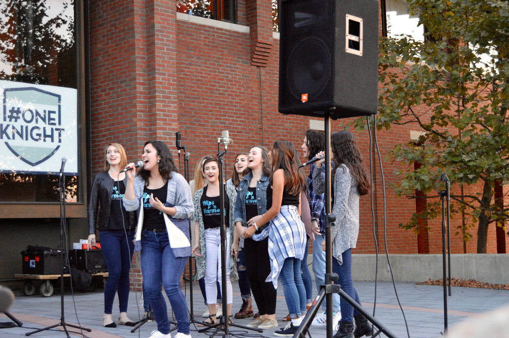 Geneseo's a cappella groups performed for students in front of the MacVittie College Union on Saturday Sept. 9. Each group displayed their distinct style and energetic tunes. (Hips N' Harmony above). (Marianna Sheedy/Staff Photographer