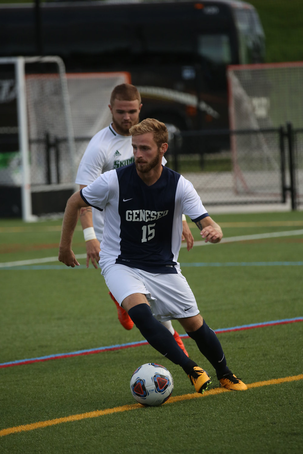 Senior midfielder Josh McIntosh takes the ball up the field in search of an open teammate during the game against Skidmore College on Saturday Sept. 9. The men have had a successful season, maintaining a record of 3-1-1. (Ash Dean/Staff Photographer)