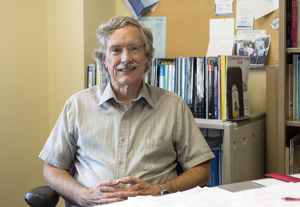 Since joining the Geneseo faculty 27 years ago, professor of mathematics Doug Baldwin has sought involvement in several aspects of the campus community. Besides teaching in multiple departments, Baldwin has also worked with the Phi Beta Kappa honor society and a variety of other student groups. (Annalee Bainnson/Photo Editor)