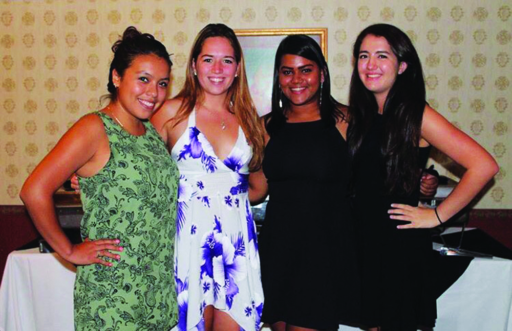 Leslie Rosales '17, senior Kaitlyn Davis, senior Sheila Khan (all Phi Lambda Chi members) and Alex at their fall 2016 formal event.
